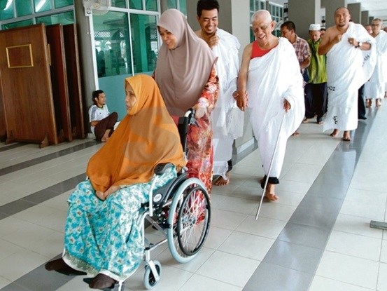 After 16 Years of Work, Disabled Couple Finally Realize Hajj Dream
